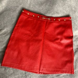 Trendy fake red leather skirt